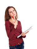 Female student with clipboard thinking Stock Photos