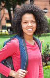Female student with curly hair looking at camera Royalty Free Stock Photos
