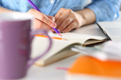 Female student or designer holding pencil and making sketches Stock Photos