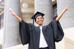 Female student diploma. Happy african american female student with diploma at graduation Royalty Free Stock Photo