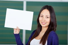 Female student displaying white paper Stock Photography