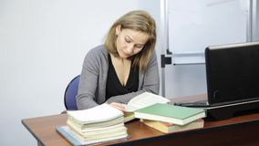 Female student does homework in front of laptop stock footage