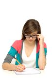 Female student doing homework Stock Photos