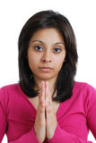 Female student doing a prayer gesture Stock Images