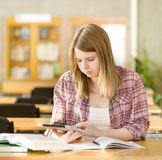 Female student with electronic pad Royalty Free Stock Images