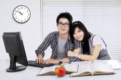 Female student embracing her boyfriend Stock Image