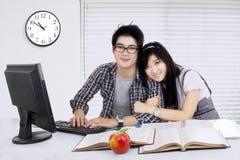 Female student embracing her boyfriend Stock Image