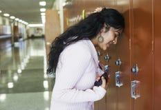 Female student failed exam. Student failed exam. Stressful girl put her head on locker stock photography