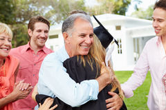 Female Student And Family Celebrating Graduation Stock Photo