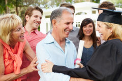 Female Student And Family Celebrating Graduation Stock Image