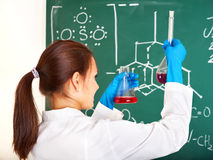 Female student with flask. Stock Photo