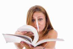 Female student flipping a book royalty free stock image