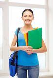 Female student with folders and bag at school Royalty Free Stock Images