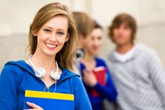 Female student with friends Stock Images