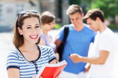 Female student with friends royalty free stock photos