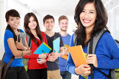 Female student and friends smiling to camera Royalty Free Stock Photography