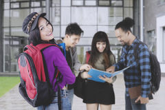 Female student with friends in the university yard Royalty Free Stock Image
