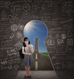 Female student in front of a success road Royalty Free Stock Photo