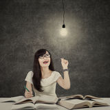 Female student getting bright inspiration 2 stock photos