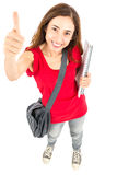 Female student giving thumbs up Royalty Free Stock Image