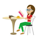 Female student with glasses reading interesting book at table Stock Image