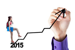 Female student go upward on the graph Royalty Free Stock Image