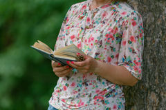 Female student with a good book in the park Royalty Free Stock Photography