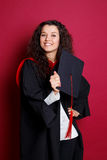 Female student in graduation gown Stock Images