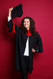 Female student in graduation gown Stock Photography