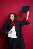 Female student in graduation gown Royalty Free Stock Photo