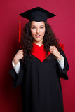 Female student in graduation gown Stock Photos