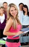 Female student with a group Royalty Free Stock Photography