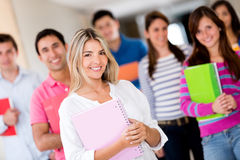 Female student with a group Royalty Free Stock Image