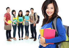 Female student with a group of people at the background Royalty Free Stock Photography