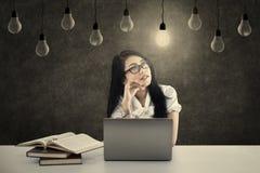 Female student has bright idea Stock Photo