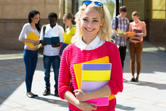 Female student with her friends Royalty Free Stock Photography