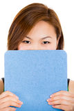 female student hiding face behind clipboard Stock Photography