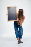 Female student holding blank board Stock Images