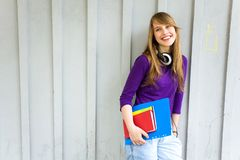 Female student holding books Royalty Free Stock Images