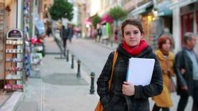 Female student holding books stock video