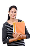 Female student holding books Royalty Free Stock Photo