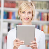 Female Student Holding Digital Tablet In Library Royalty Free Stock Images