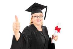 Female student holding a diploma and a thumb up Stock Images