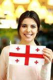 Female student holding flag of Georgia Royalty Free Stock Images