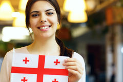 Female student holding flag of Georgia Stock Photos