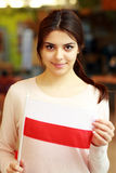Female student holding flag of Poland Stock Image