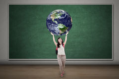 Female student is holding globe Royalty Free Stock Images