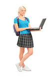 Female student holding a laptop Royalty Free Stock Photography