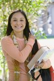 Female Student Holding Laptop And Book Royalty Free Stock Images