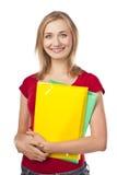Female student holding notebooks Stock Photos